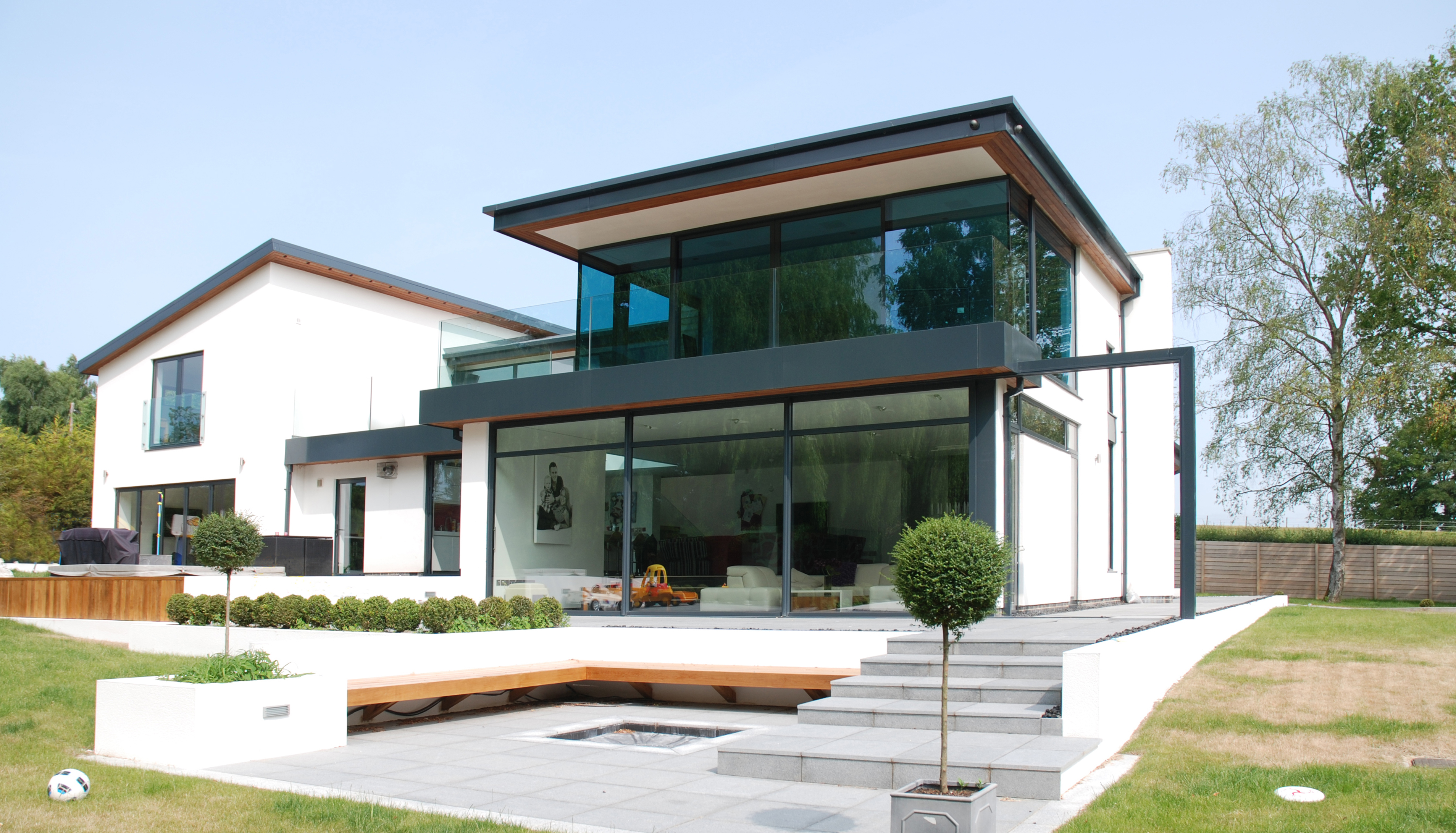 Front. A handsome new home in uncompromising contemporary styling. Spaces internally are large, open and split level and there is a great connection between inside and outside space perfect for summer entertaining. Architects in Oxfordshire, Inspiration Architects.