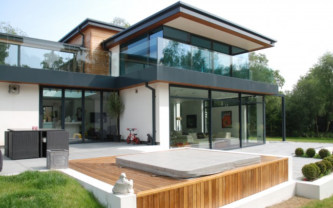Back. A handsome new home in uncompromising contemporary styling. Spaces internally are large, open and split level and there is a great connection between inside and outside space perfect for summer entertaining. Architects in Oxfordshire, Inspiration Architects.