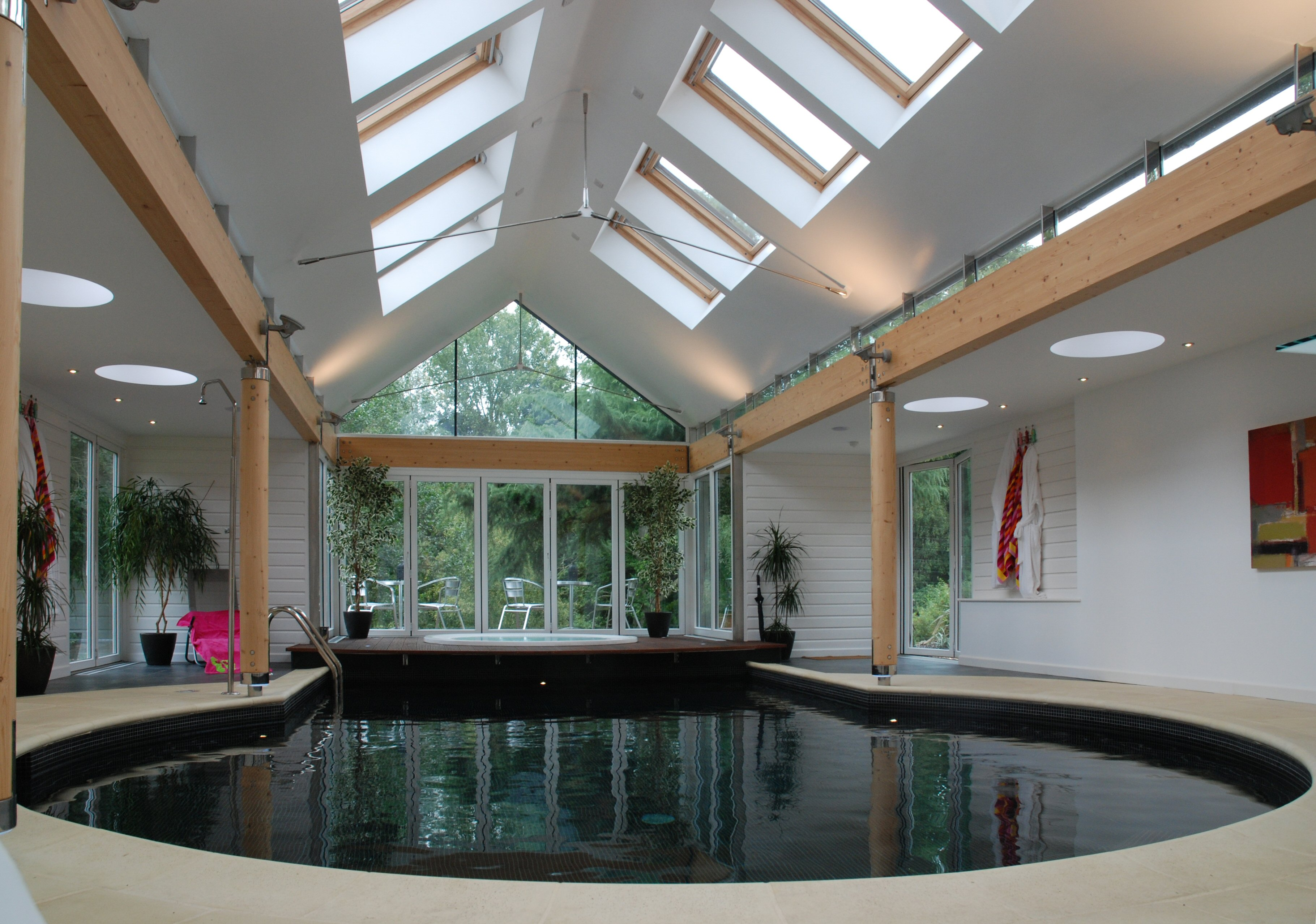 Modern private spa complex. Hot tub set in wooden decking next to a calm relaxing pool. Architectural design services from Inspiration Architects