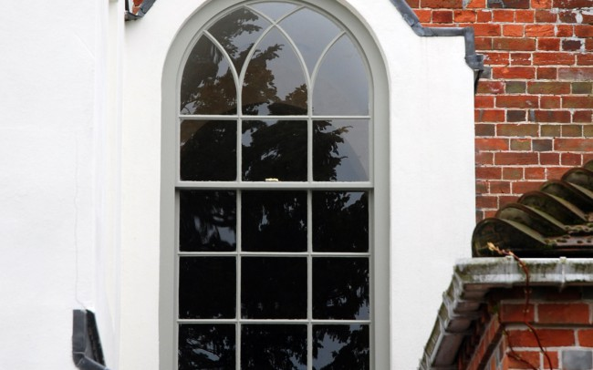 House extensions by Inspiration Architects. Exterior view of arched window, and how it has been integrated with the historical buidling.
