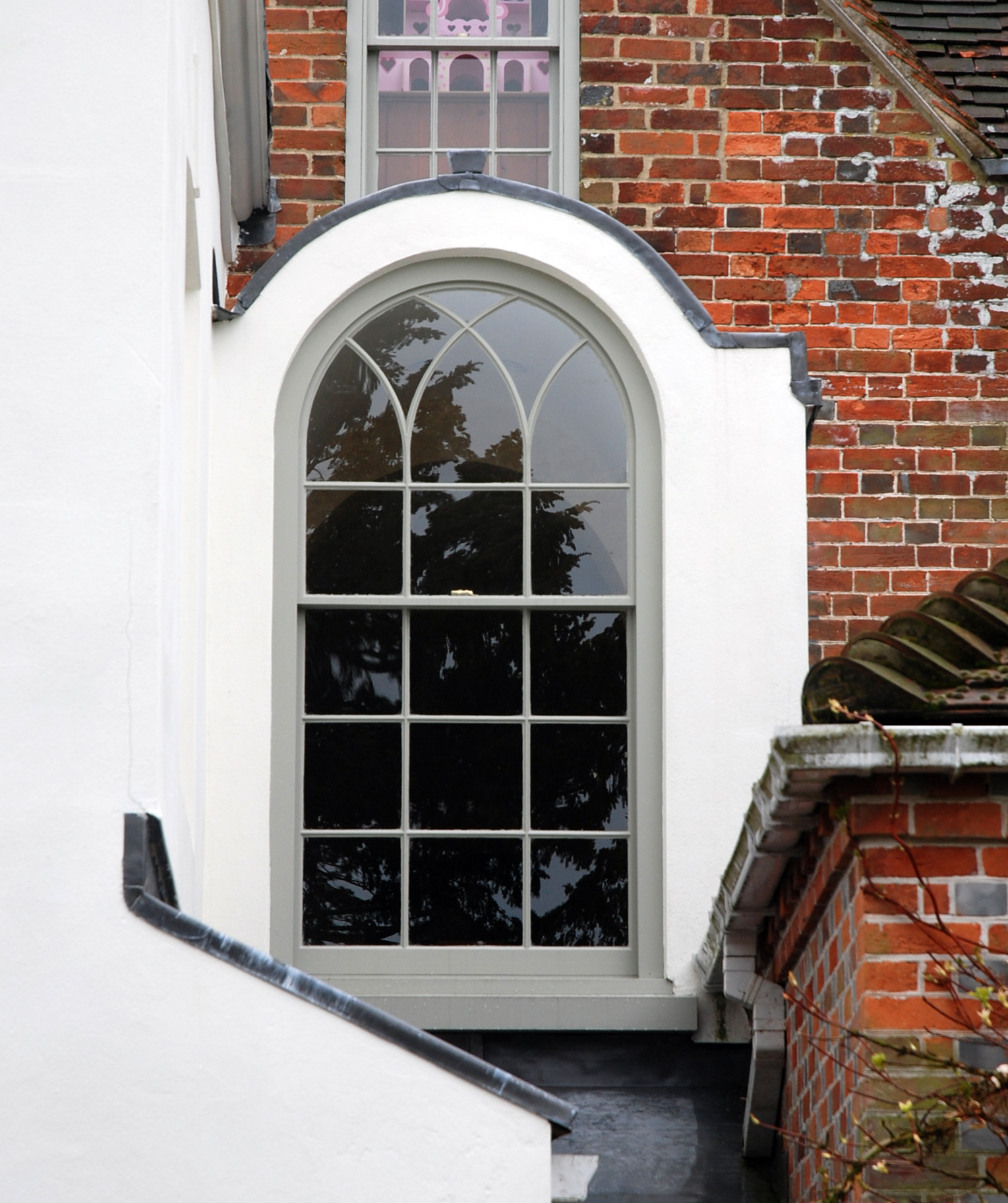 Exterior view of arched window, and how it has been integrated with the historical buidling.
