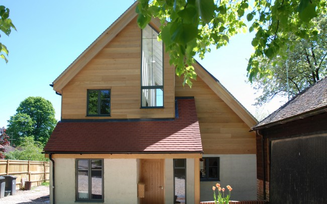 Inspiration Architects in Hampshire, new build eco home using wood and glass to give a very modern feel.