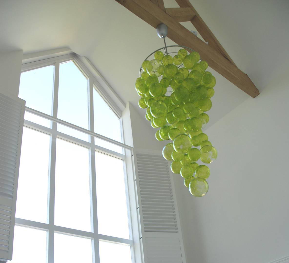 Lightshade made of green balls of glass to give the appearance of a bunch of grapes. Home architecture in Newbury by Inspiration Architecture
