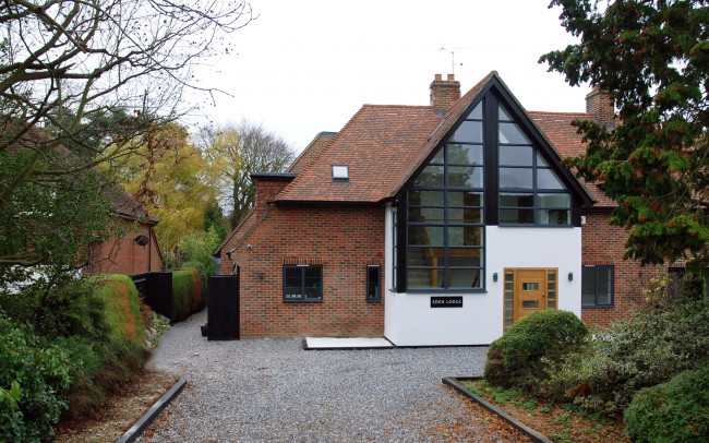 Inspiration Architects house extension design. Front gravel driverway with brick frontage.