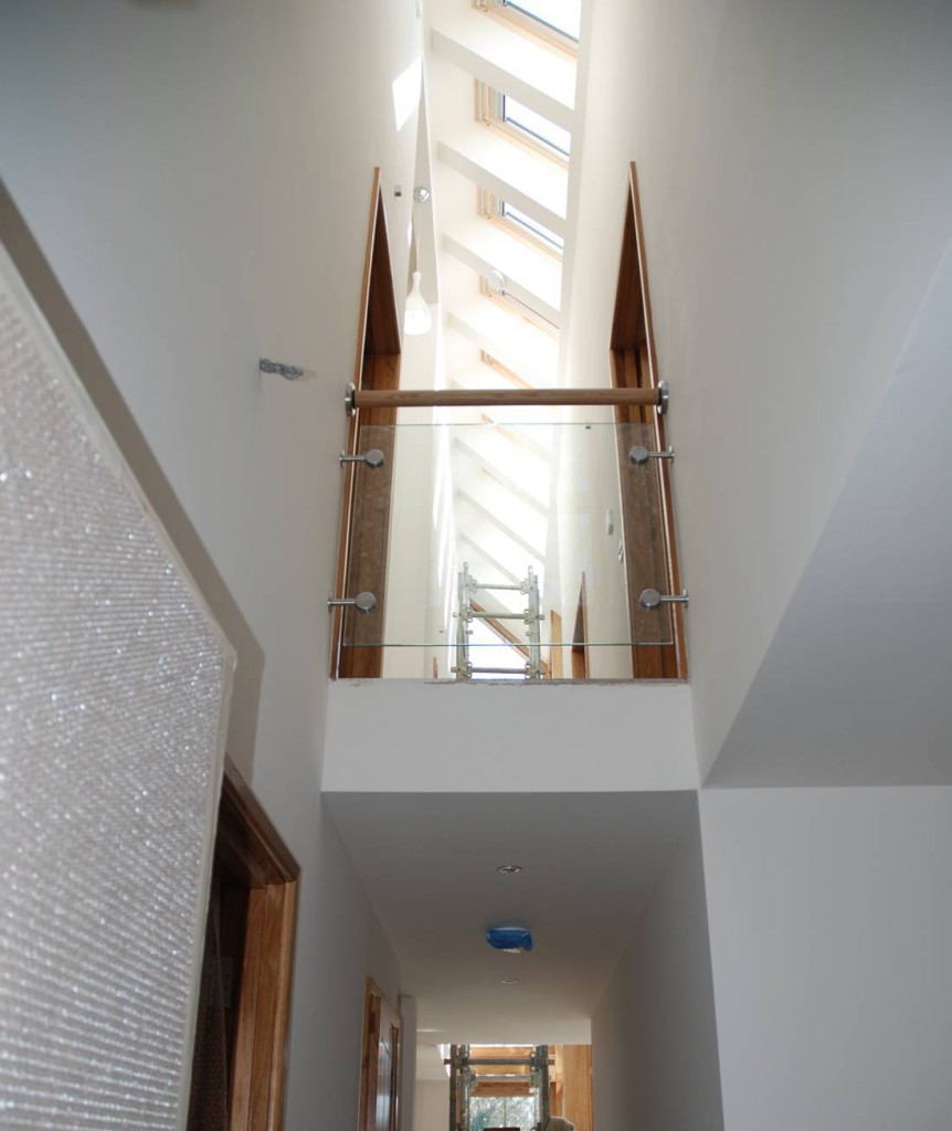 Inspiration Architects in Hampshire, new build eco home interior, wood on white design, ceiling is lined with skylights to ensure a bright welcoming feel.