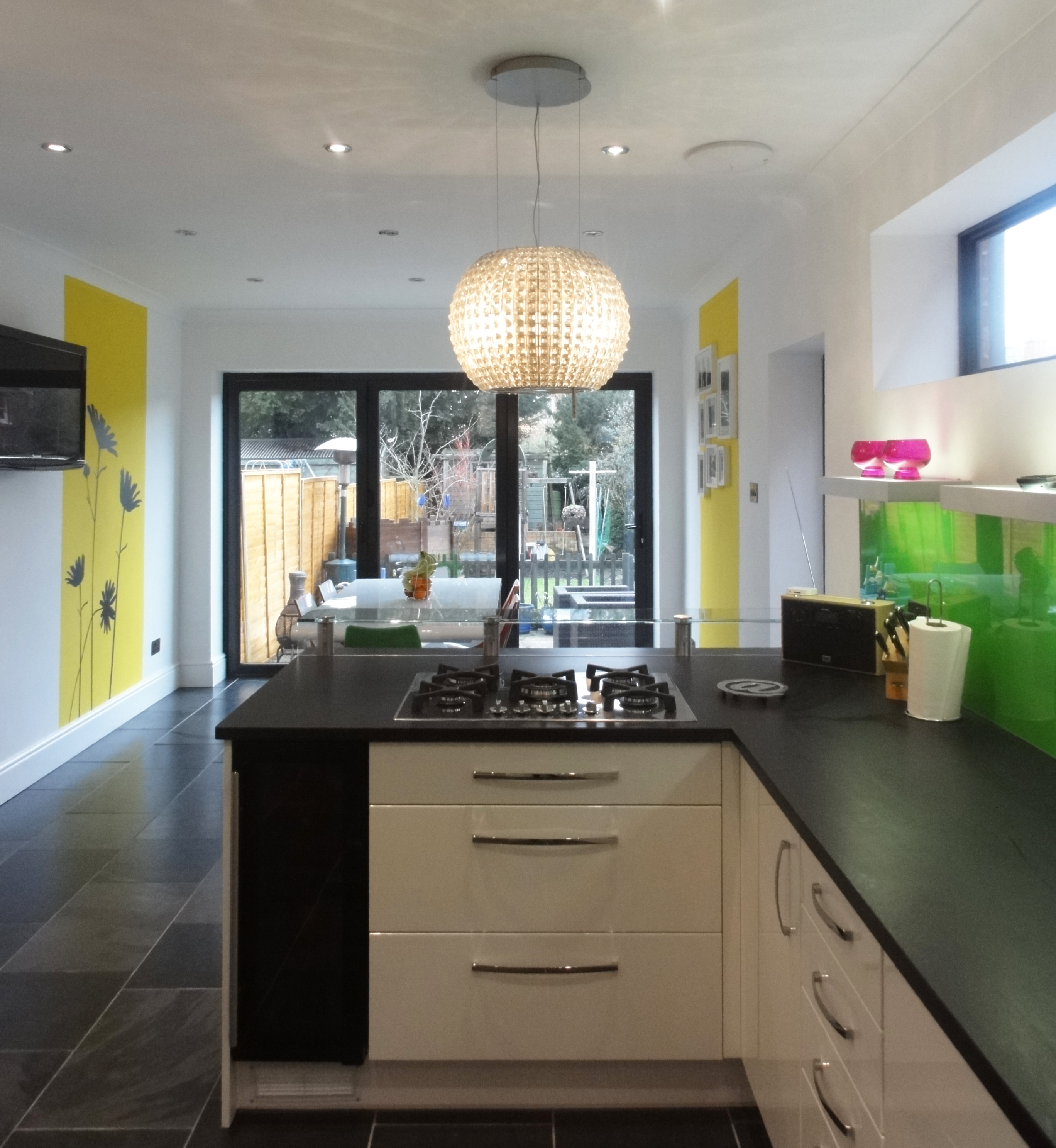 Interior architecture remodeling in Newbury by Inspiration Architects. Modern kitchen designed to let in maximum light, with granite worktops, pale wood finished cabinets and grey tiled flooring.